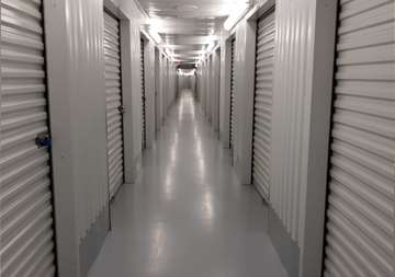 Inside row of storage units at SmartStop Self Storage facility located at 3750 FM 1488 Road, Conroe Texas
