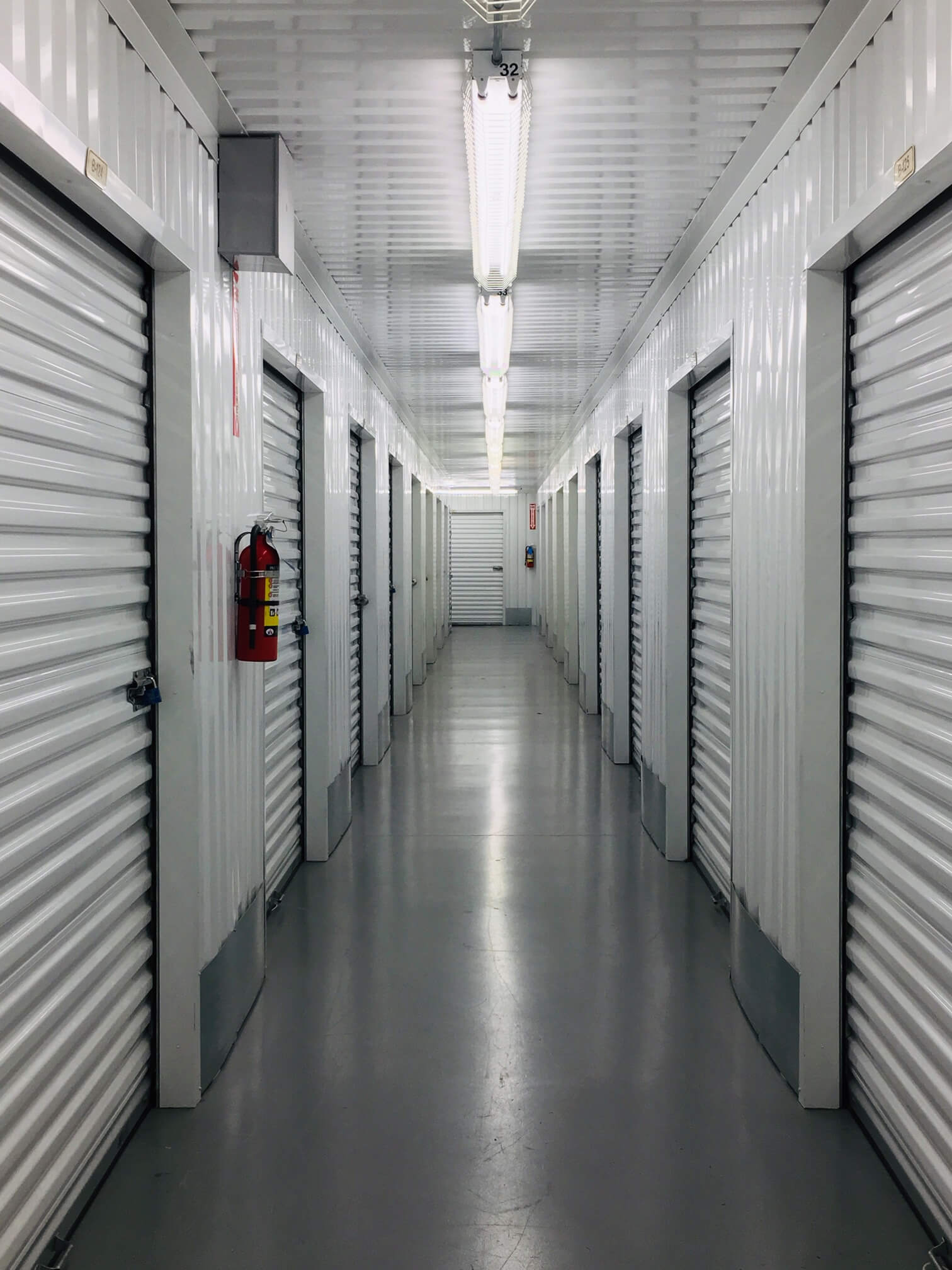 Inside row of storage units at Smart Stop self storage facility located at 20535 West Lake Houston Parkway, Humble Texas