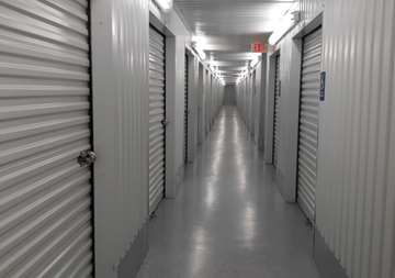 Inside row of storage units SmartStop Self Storage facility located at 8415 Queenston Blvd, Houston Texas
