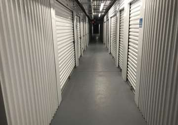 Inside row of storage units at SmartStop Self Storage facility located at 150 Airport Blvd, Morrisville North Carolina