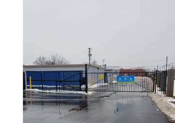 Security gate entrance at SmartStop Self Storage facility located at 24623 Ryan Road, Warren Michigan