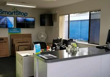Front counter inside of main office at SmartStop Self Storage facility in Everett Washington