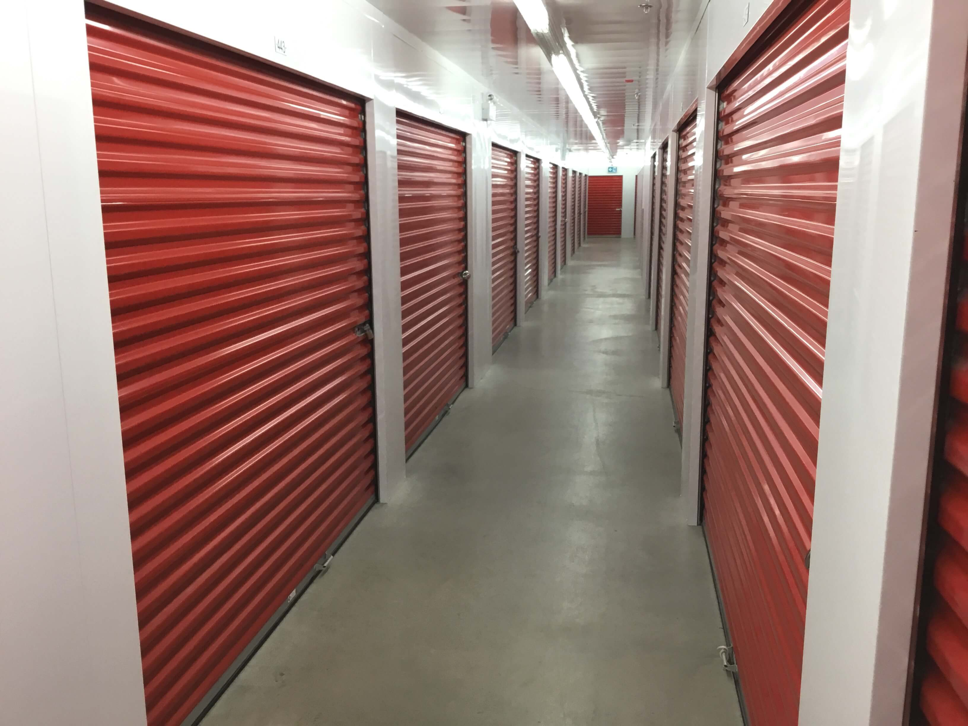 Inside row of storage uits at Smart Stop self storage facility located at 2055 Cornwall Road, Oakville Ontario Canada