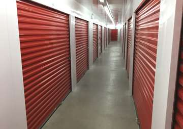 Inside row of storage units at SmartStop Self Storage facility located at 2055 Cornwall Road, Oakville Ontario Canada