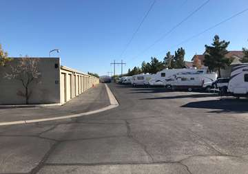 Outside row of storage units and RV parking at SmartStop Self Storage facility located at 9890 Pollock Drive, Las Vegas Nevada