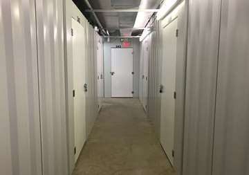 Inside row of storage units at SmartStop Self Storage facility located at 600 Patton Ave, Asheville North Carolina