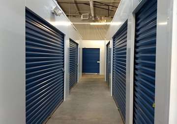 Inside row of storage units at SmartStop Self Storage facility located at 3909 Sweeten Creek Road, Arden North Carolina