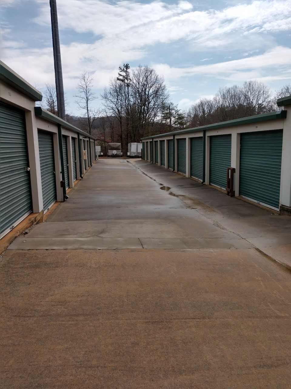 Outside row of storage units at Smart Stop self storage facility located at 2594 Sweeten Creek Road, Asheville North Carolina