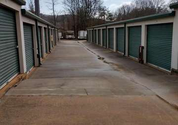 Outside row of storage units at SmartStop Self Storage facility located at 2594 Sweeten Creek Road, Asheville North Carolina