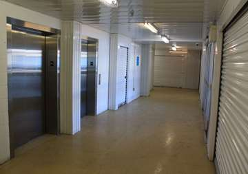Inside row of storage units at Smart Stop self storage facility located at 3136 Mavis Road, Mississauga Ontario Canada