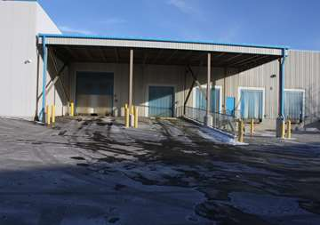 Outside covered loading dock at SmartStop Self Storage facility located at 600 Granite Ct, Pickering Ontario Canada