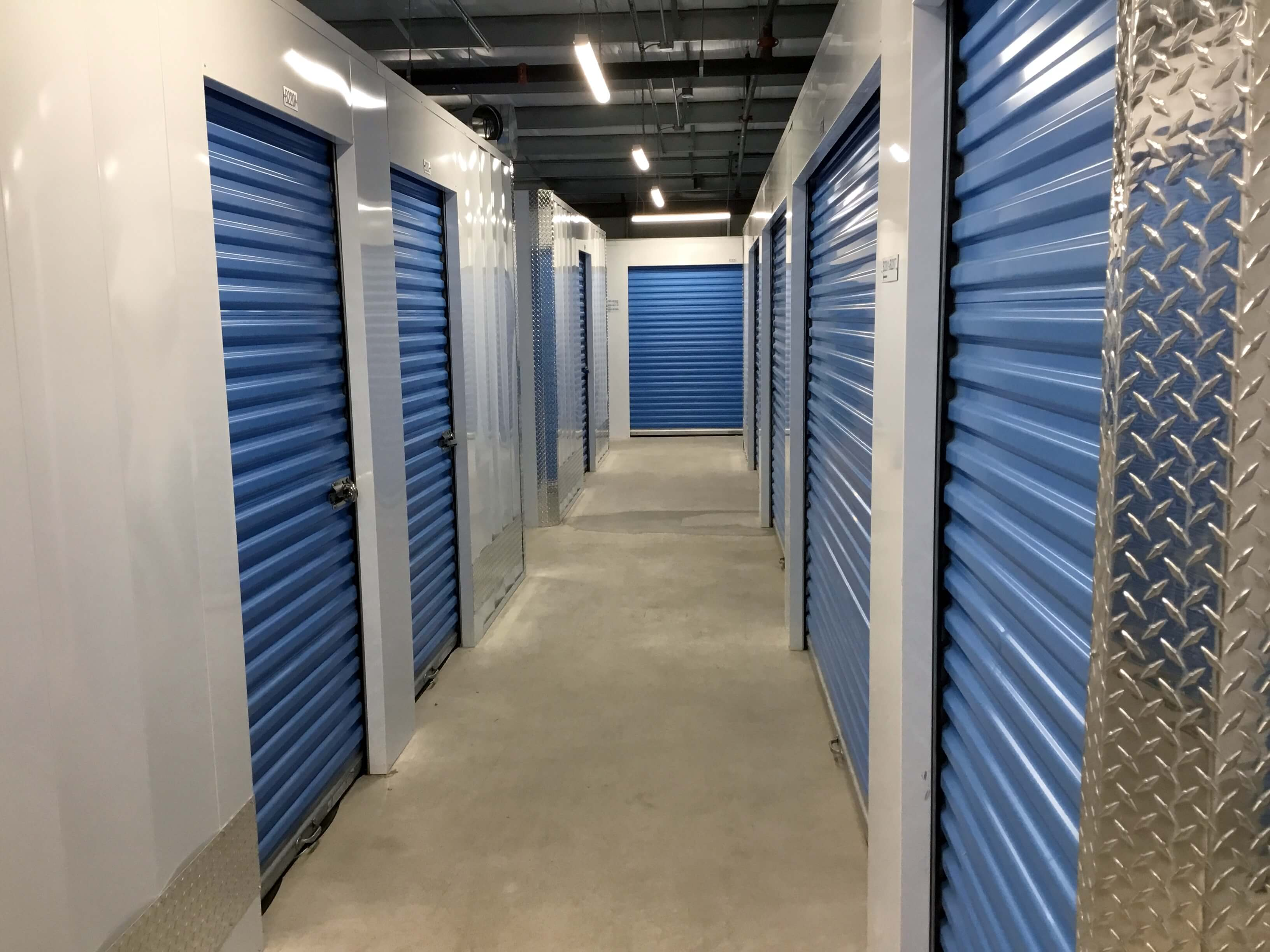 Inside row of storage units at Smart Stop self storage facility located at 515 Centennial Road North, Scarborough Ontario Canada