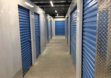 Inside row of storage units at SmartStop Self Storage facility located at 515 Centennial Road North, Scarborough Ontario Canada