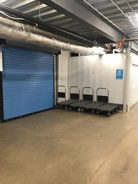 Roll up door access and courtesy carts at Smart Stop self storage facility located at 3173 Sweeten Creek Road, Asheville North Carolina