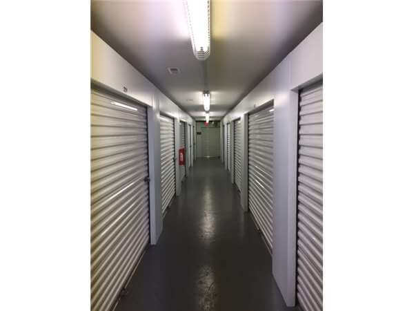 Inside row of storage units at Smart Stop self storage facility located at 197 Deaverview Road, Asheville North Carolina