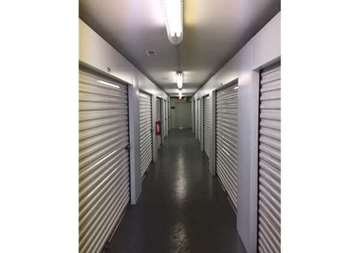 Inside row of storage units at SmartStop Self Storage facility located at 197 Deaverview Road, Asheville North Carolina