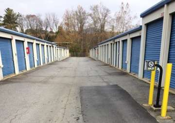 Outside row of storage units at Smart Stop self storage facility located at 75 Highland Center Blvd, Asheville North Carolina