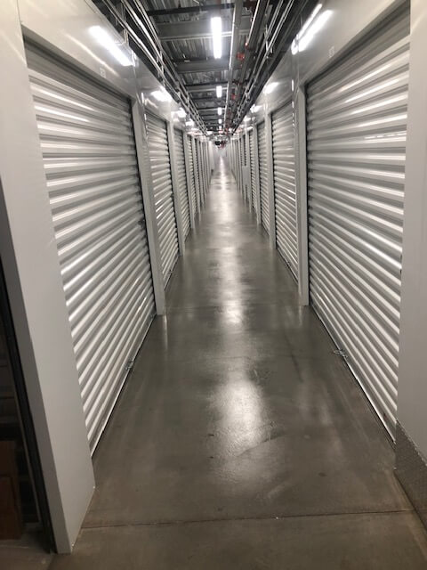Inside row of storage units at Smart Stop self storage facility located at 6888 North Hualapai Way, Las Vegas Nevada