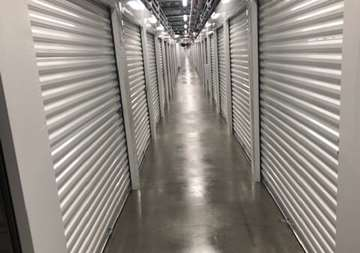 Inside row of storage units at SmartStop Self Storage facility located at 6888 North Hualapai Way, Las Vegas Nevada