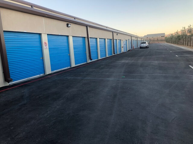 Outside row of storage units at Smart Stop self storage facility located at 6888 North Hualapai Way, Las Vegas Nevada