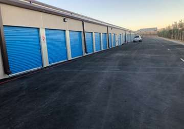 Outside row of storage units at SmartStop Self Storage facility located at 6888 North Hualapai Way, Las Vegas Nevada