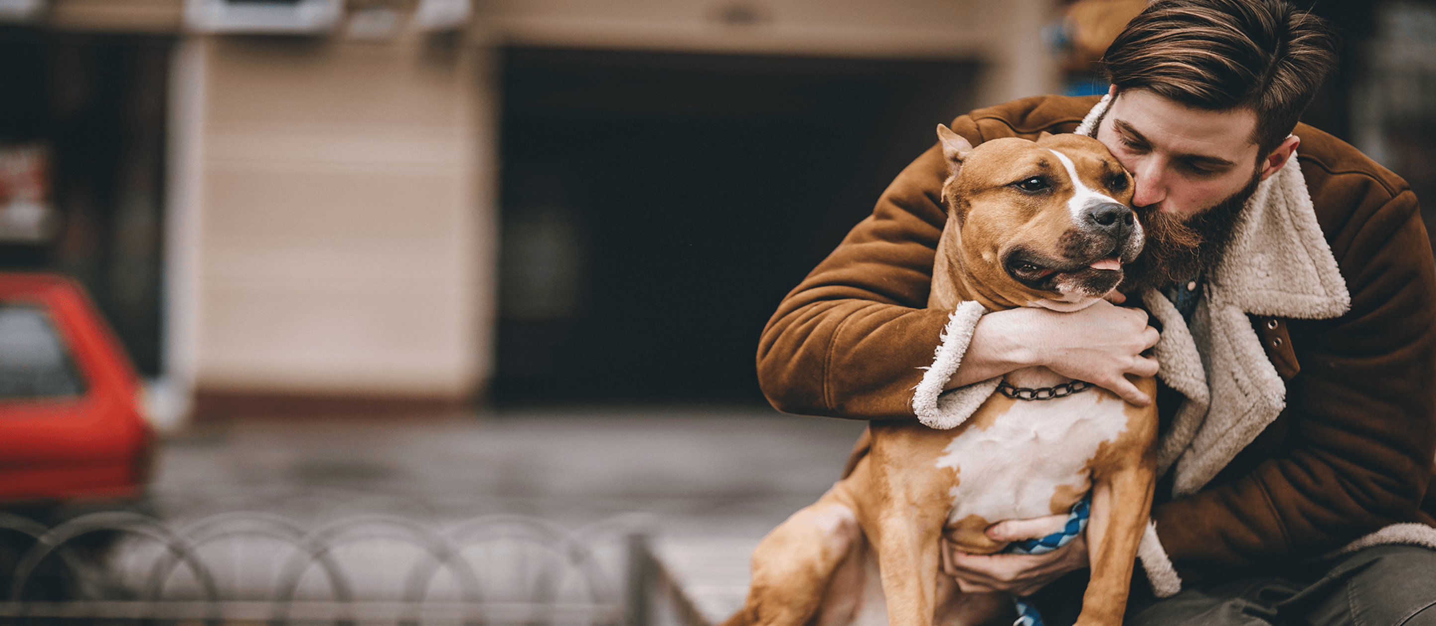 Image of man hugging his dog