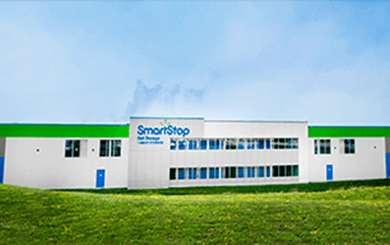 Image of a SmartStop building exterior with green grass and blue sky