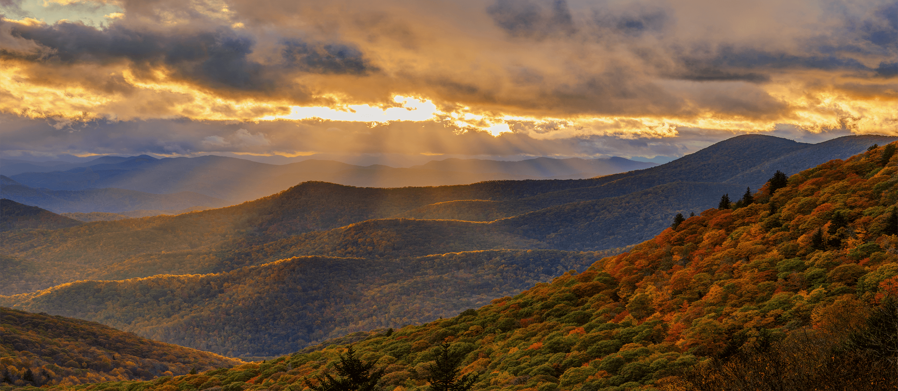 Image of mountain chain with clouds at sunset