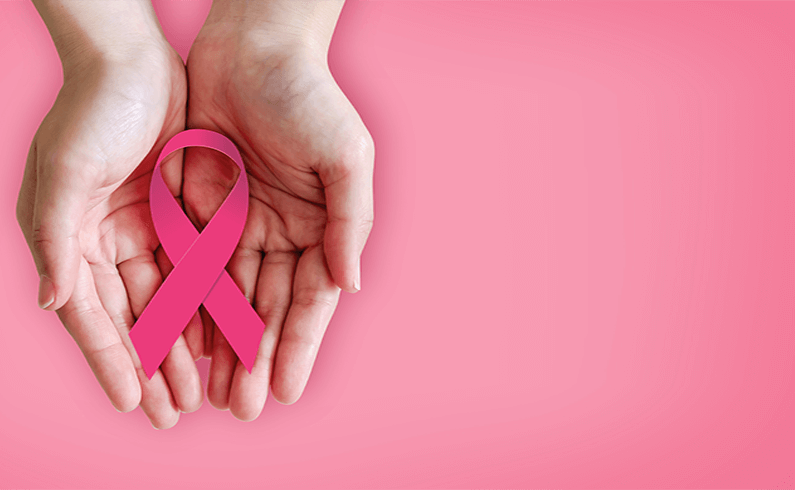 Image of two hands holding a pink ribbon