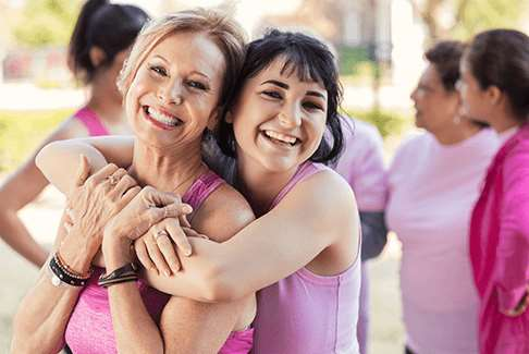 Image of two happy women hugging