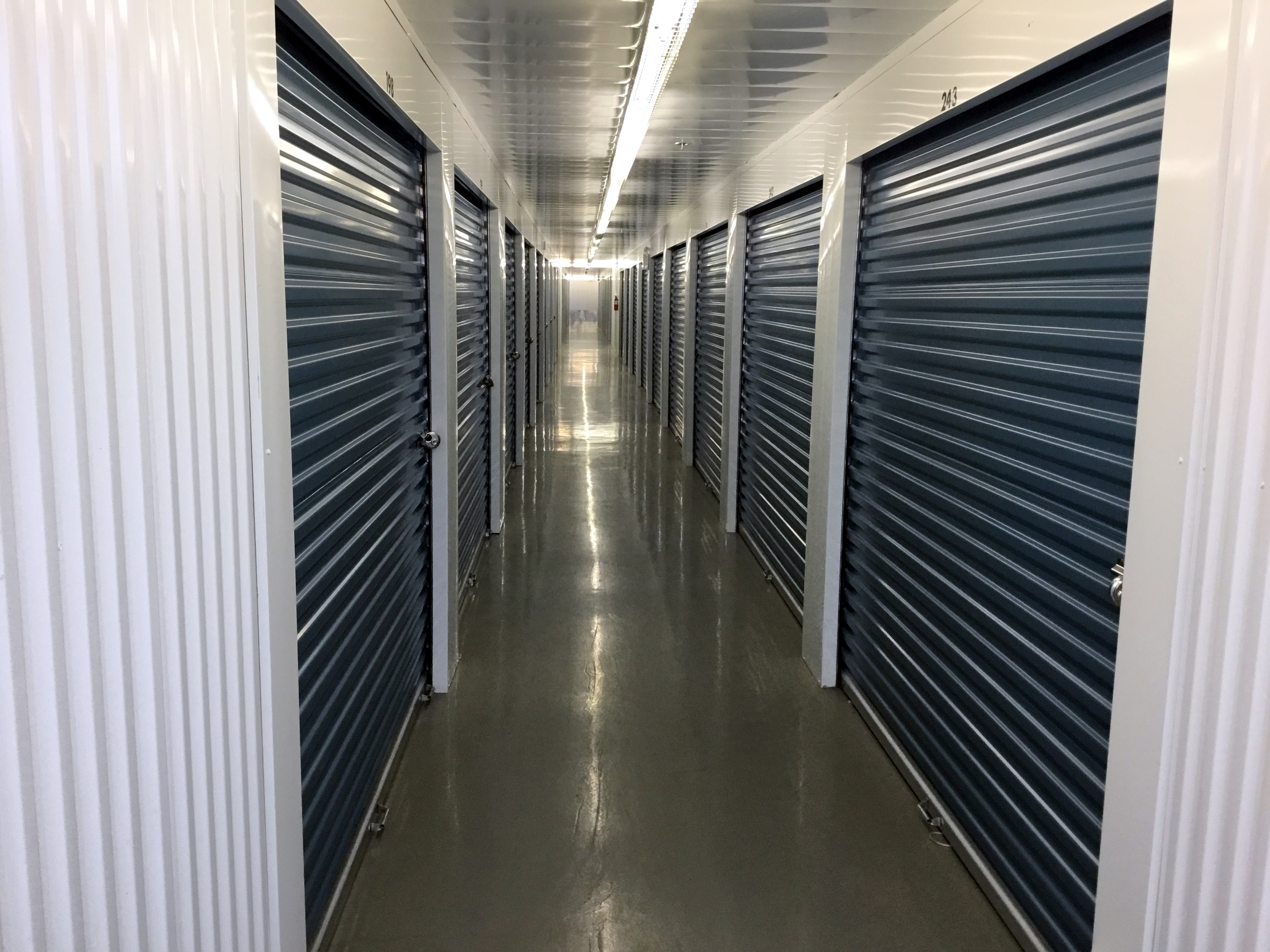 Inside row of storage units at Smart Stop self storage facility located at 480 South Service Road West, Oakville Ontario Canada
