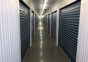 Inside row of storage units at SmartStop Self Storage facility located at 480 South Service Road West, Oakville Ontario Canada