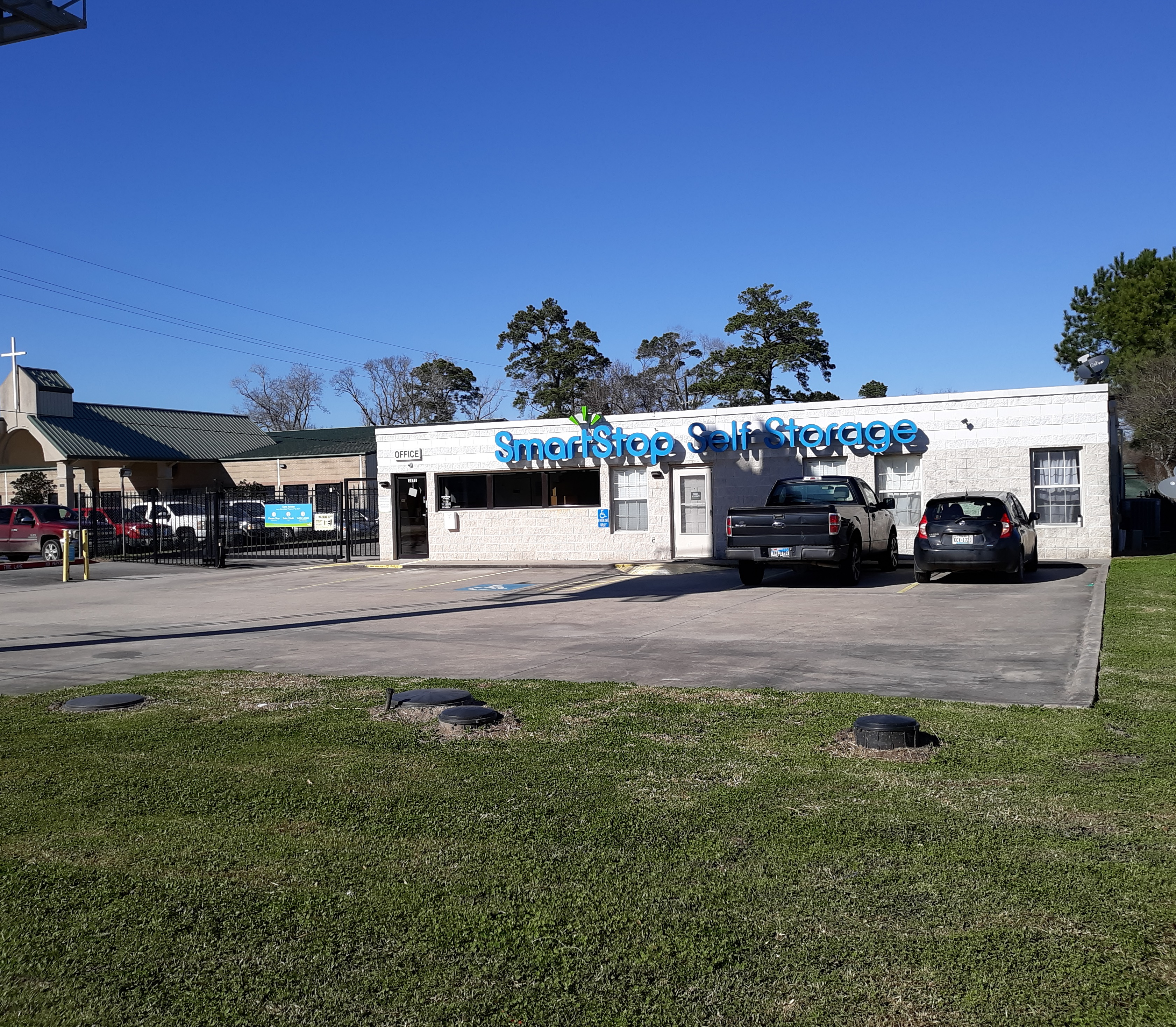 Front view of Smart Stop Self Storage facility at 1671 Northpark Drive in Kingwood Texas
