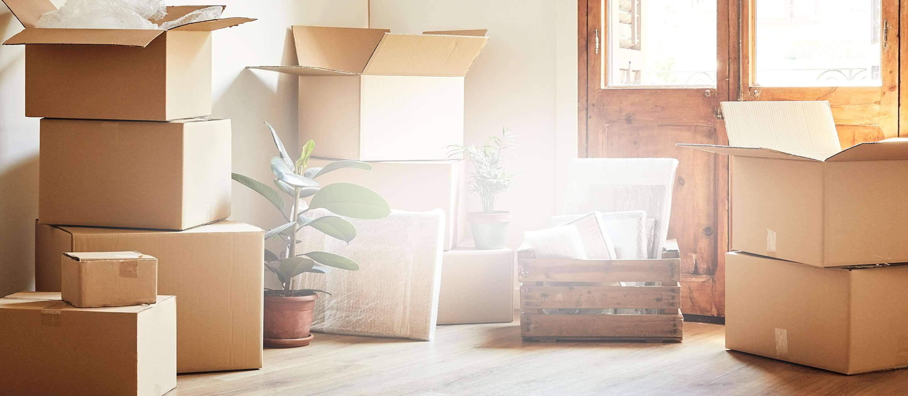 Image of opened moving boxes inside a house