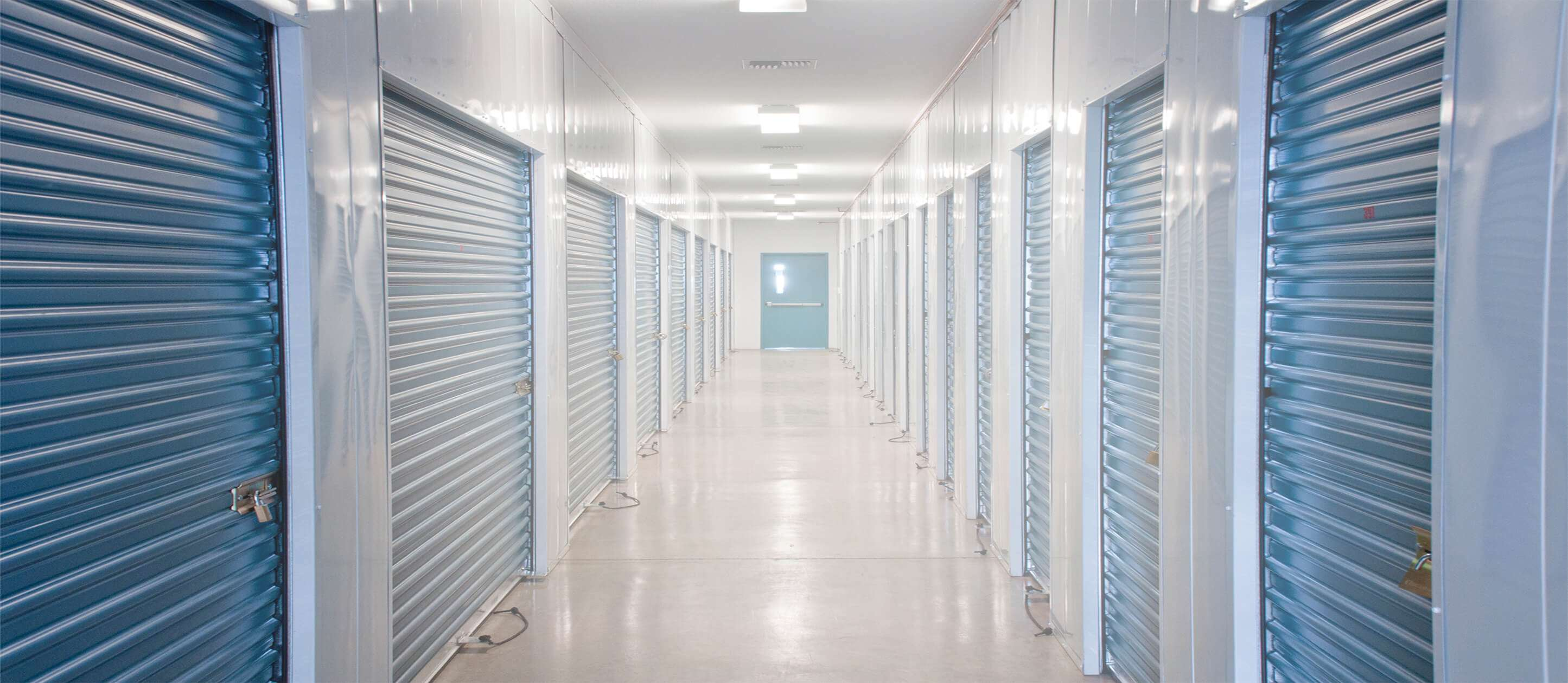 Image of a long corridor of indoor storage units