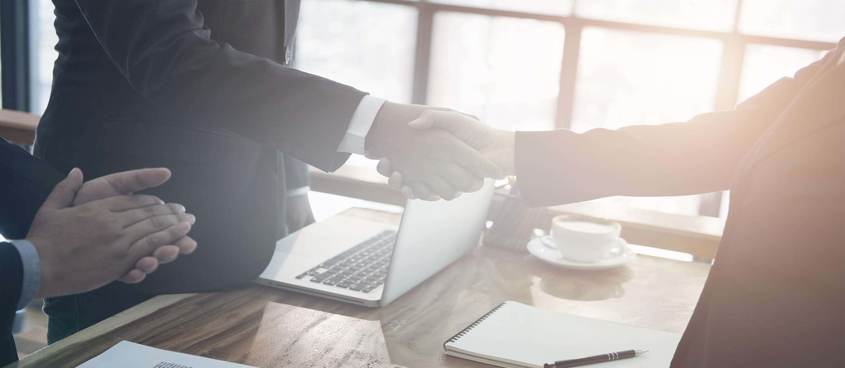 Image of two business persons shaking hands