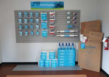 Moving and packaging supplies within front office of SmartStop Self Storage facility in Puyallup, Washington