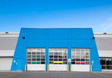 Outside view of three high bay loading doors at SmartStop Self Storage facility located at 365 Fruitland Road, Stoney Creek Ontario Canada