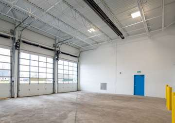 Inside of covered loading dock with roll up doors at SmartStop Self Storage facility located at 365 Fruitland Road, Stoney Creek Ontario Canada