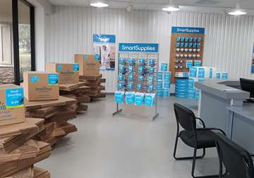 Available moving supplies for sale within front office at SmartStop Self Storage facility located at 3750 FM 1488 Road, Conroe Texas